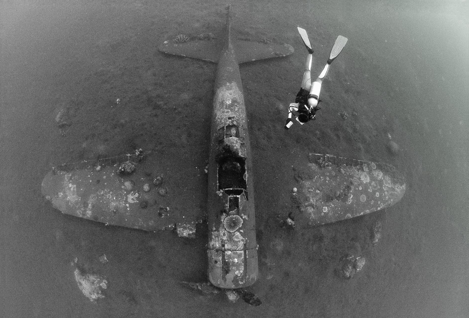An incredibly intact wreck of a Japanese Mitsubishi Zero fighter plane from WWII , Papua New Guinea. Click on the image to see the full gallery from this location